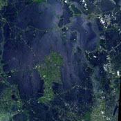 NASA's Terra spacecraft acquired this image of flooding from the Chao Phraya River, Thailand on Nov. 8, 2011. The muddy water that had overflowed the banks of the river, flooding agricultural fields and villages, is seen in dark blue and blue-gray.