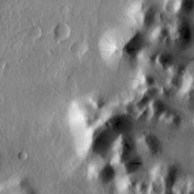 Mass Wasting is the term given to the process of change on a surface due to gravity (things moving downhill due to the force of gravity). Dark streaks mark the slopes of craters and hills in this region of Amazonis Planitia.