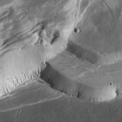 This image captured by NASA's 2001 Mars Odyssey spacecraft shows part of the complex caldera at the summit of Ascraeus Mons.
