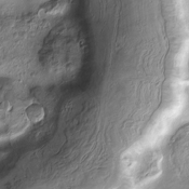 A small section of Dao Vallis in shown in this image from NASA's 2001 Mars Odyssey spacecraft. Dao Vallis is a major channel that drains into Hellas Planitia.