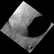 This image, one of the first obtained by NASA's Dawn spacecraft in its low altitude mapping orbit, shows part of the rim of a fresh crater on the giant asteroid Vesta. The terrain is known as the Heavily Cratered Terrain in the northern hemisphere.