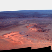 This false-color mosaic of images shows the windswept vista northward (left) to northeastward (right) from the location where NASA's Mars Exploration Rover Opportunity is spending its fifth Martian winter, an outcrop informally named 'Greeley Haven.'