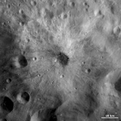 This image from NASA's Dawn spacecraft is centered on a small, young, fresh crater with bright and dark ejecta rays extending from it. The crater is located in Vesta's Tuccia quadrangle on asteroid Vesta.