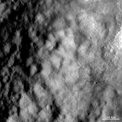 This image from NASA's Dawn spacecraft shows part of the ejecta deposit surrounding the 'snowman' craters, the largest of which has been named Marcia.