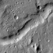 The unnamed channel in this image from NASA's 2001 Mars Odyssey spacecraft is located in northern Tyrrhena Terra.