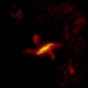 This parallelogram shaped region of dust observed by ESA's Herschel Space telescope can be best described using galaxy formation models where a flat spiral galaxy collides with an elliptical galaxy becoming warped in the process.