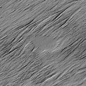 The wind eroded surface in this image from NASA's 2001 Mars Odyssey spacecraft is located in Zephyria Planum.
