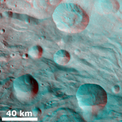 This anaglyph from NASA's Dawn spacecraft shows degraded craters shows partially degraded craters and ridges in asteroid Vesta's Pinaria quadrangle. You need 3D glasses to view this image.