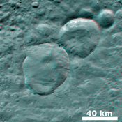 This anaglyph from NASA's Dawn spacecraft shows three fresh craters on asteroid Vesta, which have been nicknamed the 'Snowman' craters. You need 3D glasses to view this image.