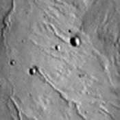 The channels in this image from NASA's 2001 Mars Odyssey spacecraft are dissecting the northwestern flank of Alba Mons.