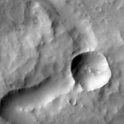 The channel in this image from NASA's 2001 Mars Odyssey spacecraft is located in Terra Sabaea. At some time after the channel was carved, the impact event occurred, forever blocking the channel.