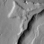 The channels in this image are part of a multitude of channels that dissect the eastern flank of Tempe Terra.