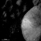 This image of asteroid Vesta from NASA's Dawn spacecraft shows part of a large crater with a relatively fresh rim located in Vesta's Numisia quadrangle, near the equator.