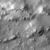 This image captured by NASA's 2001 Mars Odyssey spacecraft shows the southern rim of Lockyer Crater and part of its ejecta blanket.