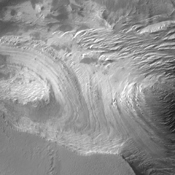 This image of Candor Chasma captured by NASA's 2001 Mars Odyssey spacecraft shows layered floor materials.