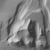 A sand sheet and dune forms are present on the floor of Capri Chasmain this image from NASA's 2001 Mars Odyssey spacecraft.