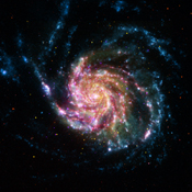 This image of the Pinwheel Galaxy, or M101, in the constellation of Ursa Major, combines data from four of NASA's space telescopes. The view shows that both young and old stars are evenly distributed along M101's tightly wound spiral arms.