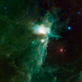 The Flame Nebula sits on the eastern hip of Orion the Hunter, a constellation most easily visible in the northern hemisphere during winter evenings in this view from NASA's WISE Telescope.