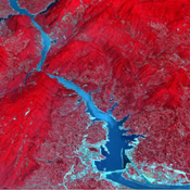 Acquired by NASA's Terra spacecraft, this image shows the Three Gorges Dam which spans the Yangtze River in east-central China, and is the world's largest power station in terms of installed capacity.