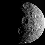The shadowy outlines of the terrain in Vesta's northern region are visible in this image from NASA's Dawn spacecraft. The image comes from the last sequence of images Dawn obtained of the giant asteroid Vesta as it departed the giant asteroid.