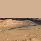 This image shows changes in the target landing area for Curiosity, NASA's Mars Science Laboratory rover. The larger ellipse for the target area has been revised to the smaller ellipse centered nearer to the foot of Mount Sharp, inside Gale Crater.