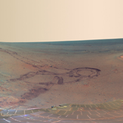 This full-circle scene combines 817 images, taken by the panoramic camera on NASA's Mars Exploration Rover Opportunity, showing the terrain that surrounded the rover while it was stationary for four months of work during its most recent Martian winter.