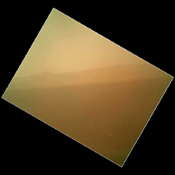 This view of the landscape to the north of NASA's Mars rover Curiosity acquired by the Mars Hand Lens Imager on the afternoon of the first day of landing. In the distance, the image shows the north wall and rim of Gale Crater.