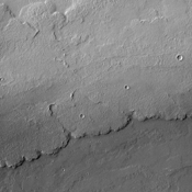 The volcanic flows in image from NASA's 2001 Mars Odyssey spacecraft are located south of Ascraeus Mons and east of Pavonis Mons.