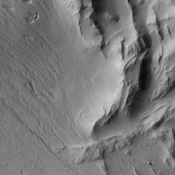 This image from NASA's 2001 Mars Odyssey spacecraft is of Lycus Sulci, located on the western side of Olympus Mons and dominated by multi-direction ridges which contains material less resistant than the ridges to the effects of wind.