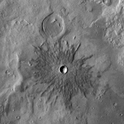 This image from NASA's 2001 Mars Odyssey spacecraft shows a small crater near Phlegra Montes.