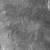 This image captured by NASA's 2001 Mars Odyssey spacecraft shows a small portion of Daedalia Planum, which is mainly comprised of lava flows related to Arsia Mons.