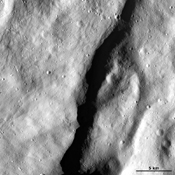 This image from NASA's Dawn spacecraft shows an escarpment located in asteroid Vesta's near Rheasilvia quadrangle, near Vesta's south pole.