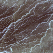 Acquired by NASA's Terra spacecraft on in 2011, this image shows the Wadi As-Sirhan Basin in northwest Saudi Arabia, which has been steadily developing agricultural fields using center pivot irrigation by tapping into fossil ground water.