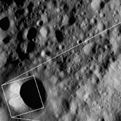 These images from NASA's Dawn spacecraft are located in asteroid Vesta's Floronia quadrangle, in Vesta's northern hemisphere; small boulders visible inside of Scantia crater.