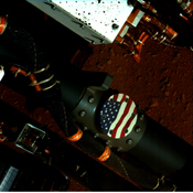 This view of the American flag medallion on NASA's Mars rover Curiosity was taken by the rover's MAHLI camera during the 44th Martian sol on Sept. 19, 2012. The flag is one of four 'mobility logos' placed on the rover's mobility rocker arms.