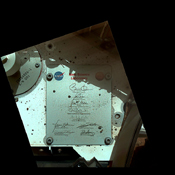 This view of Curiosity's deck shows a plaque bearing several signatures of US officials, including that of President Obama and Vice President Biden. The image was taken by the rover's Mars Hand Lens Imager (MAHLI).