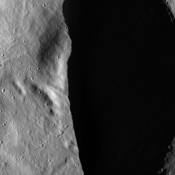 These images from NASA's Dawn spacecraft, located in asteroid Vesta's Oppia quadrangle, in Vesta's northern hemisphere, demonstrate a special analytical technique, which results in shadowed areas of Vesta's surface becoming illuminated.