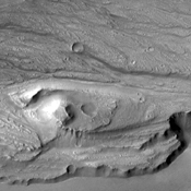 This image from NASA's 2001 Mars Odyssey spacecraft shows small channels at many different elevations, all part of the complex region between the northern and southern (bottom of image) main channels of Kasei Valles.