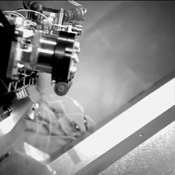 This frame from a video shows an engineering test for NASA's Curiosity rover. During the test, the clear dust covers on the Hazard-Avoidance cameras were popped off.