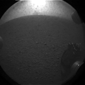 This is the first image taken by NASA's Curiosity rover, which landed on Mars the evening of Aug. 5 PDT (morning of Aug. 6 EDT). It was taken through a