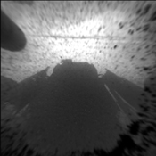 This is a version of one of the first images taken by a front Hazard-Avoidance camera on NASA's Curiosity rover. It was taken through a