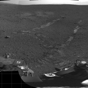 This 360-degree panorama shows evidence of a successful first test drive for NASA's Curiosity rover; the rover made its first move, going forward about 15 feet (4.5 meters), rotating 120 degrees and then reversing about 8 feet (2.5 meters).