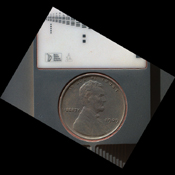 The penny in this image is part of a camera calibration target on NASA's Mars rover Curiosity. The MAHLI camera on the rover took this image of the MAHLI calibration target during the 34th Martian day of Curiosity's work on Mars, Sept. 9, 2012.