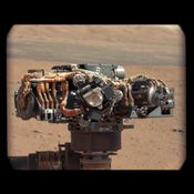This image shows the Mars Hand Lens Imager (MAHLI) on NASA's Curiosity rover, with the Martian landscape in the background. The image was taken by Curiosity's Mast Camera on the 32nd Martian day, or sol, of operations on the surface.