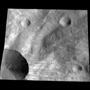 This image from NASA's Dawn spacecraft shows a close up of part of the rim around the crater Canuleia on the giant asteroid Vesta. Canuleia, about 6 miles (10 kilometers) in diameter, is the large crater at the bottom-left of this image.