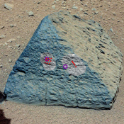 This image shows where NASA's Curiosity rover aimed two different instruments to study a rock known as 'Jake Matijevic.' The red dots are where ChemCam zapped the rock with its laser.