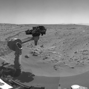 Smooth surfaces of windblown sand and dust of the 'Rocknest' area signal an appropriate place for NASA's Curiosity to collect and use the mission's first few scoopfuls of soil.
