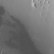 Continuing eastward, this image of Gale captured by NASA's 2001 Mars Odyssey spacecraft shows the reappearance of dunes on the crater floor near the margin of Mt. Sharp.