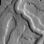 The channel feature in this image captured by NASA's Mars Odyssey spacecraft is part of Tyrrhena Fossae, a large depression that dissects Tyrrhena Mons.