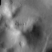 Small gullies captured in this image from NASA's 2001 Mars Odyssey are located on the north and south sides of this hill. The hill is part of the mountainous region that borders the northeastern side of Argyre Planitia.